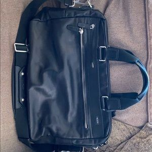 Tumi slim brief. leather, black. Mint condition.